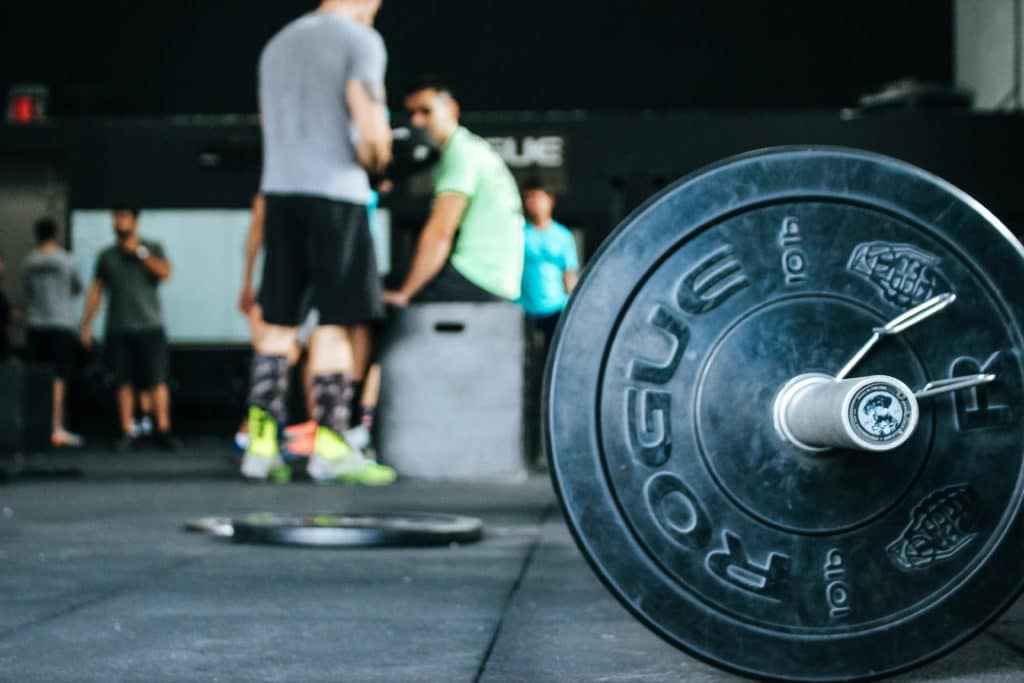 Weights in a weight room with people working out