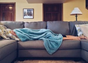 sick person with decreased immune system on couch