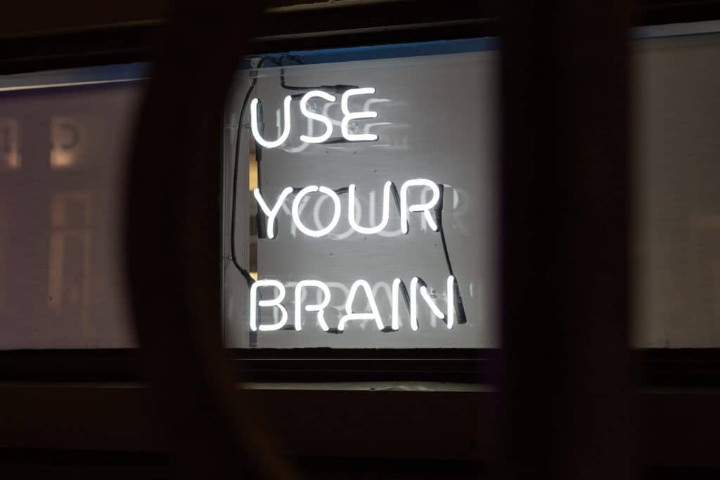 "neon sign that says ""use your brain"""