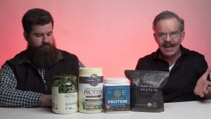 Plant Protein Powders options on table in front of Brian and Ed